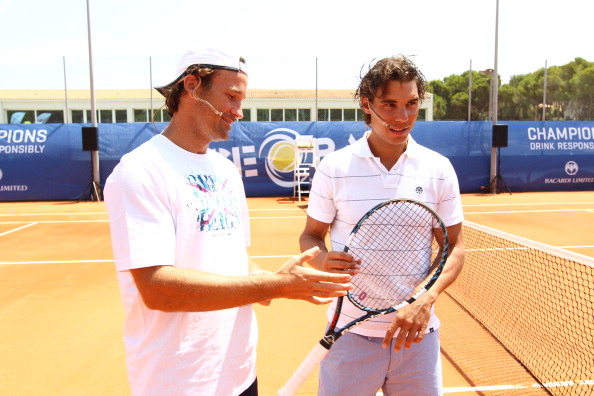 MAJORCA, SPAIN - JULY 21: Former tennis player Carlos Moya (L) and Rafael Nadal attend the Bacardi Limited 'Champions Drink Responsibly' event on July 21, 2012 in Mallorca, Spain. (Photo by Getty Images for Bacardi)
