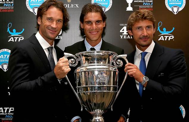 Spaniards Carlos Moya, Rafael Nadal and Juan Carlos Ferrero pose with the ATP World Tour No. 1 trophy. ©Ella Ling