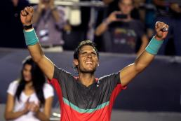 Nadal of Spain reacts after winning in the Rio de Janeiro Open men's final tennis match