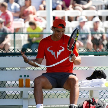 Rafa happily re-grips his racket. Photo by Maria Noble/Tennis View Magazine