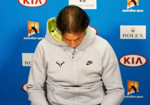 Rafael Nadal of Spain arrives at a news conference after being defeated by Tomas Berdych of the Czech Republic in their men's singles quarter-final match at the Australian Open 2015 tennis tournament in Melbourne