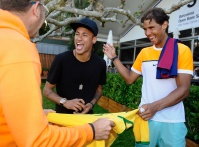 BARCELONA, SPAIN - APRIL 22: Rafael Nadal (R) of Spain laughs as Neymar of FC Barcelona signs autographs during day three of the Barcelona Open Banc Sabadell at the Real Club de Tenis Barcelona on April 22, 2015 in Barcelona, Spain. (Photo by fotopress/Getty Images)
