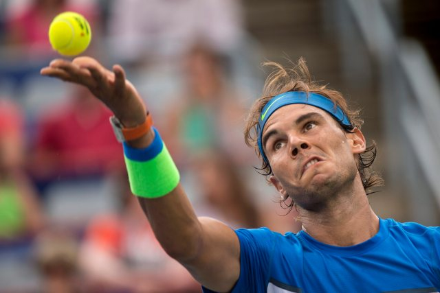 Rafael Nadal, of Spain, serves to Sergiy Stakhovsky, of Ukraine, during the Rogers Cup men's tennis tournament, Wednesday, Aug. 12, 2015, in Montreal. (Paul Chiasson/The Canadian Press via AP) MANDATORY CREDIT