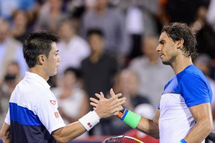 MONTREAL, ON - AUGUST 14: Kei Nishikori of Japan shakes hands with Rafael Nadal of Spain after defeating him during day five of the Rogers Cup at Uniprix Stadium on August 14, 2015 in Montreal, Quebec, Canada. Kei Nishikori defeated Rafael Nadal 6-2, 6-4. (Photo by Minas Panagiotakis/Getty Images)