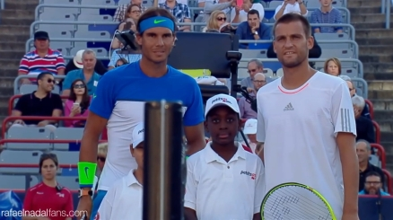 Rafael Nadal and Mikhail Youzhny pose for a photo before their match at Rogers Cup in Montreal