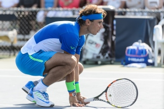 MONTREAL, ON - AUGUST 10: Rafael Nadal of Spain crouches down during day one of the Rogers Cup at Uniprix Stadium in his doubles match against Tomas Berdych of the Czech Republic and Jack Sock of the USA on August 10, 2015 in Montreal, Quebec, Canada. (Photo by Minas Panagiotakis/Getty Images)