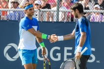 MONTREAL, ON - AUGUST 10: Rafael Nadal of Spain encourages teammate Fernando Verdasco of Spain during day one of the Rogers Cup at Uniprix Stadium in his doubles match against Tomas Berdych of the Czech Republic and Jack Sock of the USA on August 10, 2015 in Montreal, Quebec, Canada. (Photo by Minas Panagiotakis/Getty Images)