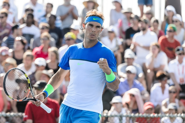 MONTREAL, ON - AUGUST 10:  Rafael Nadal of Spain reacts after scoring a point during day one of the Rogers Cup at Uniprix Stadium in his doubles match against Tomas Berdych of the Czech Republic and Jack Sock of the USA on August 10, 2015 in Montreal, Quebec, Canada.  (Photo by Minas Panagiotakis/Getty Images)