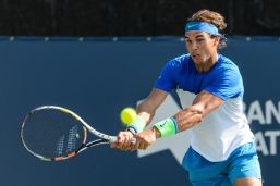 MONTREAL, ON - AUGUST 10: Rafael Nadal of Spain returns the ball during day one of the Rogers Cup at Uniprix Stadium in his doubles match against Tomas Berdych of the Czech Republic and Jack Sock of the USA on August 10, 2015 in Montreal, Quebec, Canada. (Photo by Minas Panagiotakis/Getty Images)