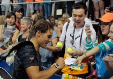NEW YORK, NY - AUGUST 26: Rafael Nadal signs autographs right after his Johnny Mac Tennis Project 2015 Benefit Match at Randall's Island on August 26, 2015 in New York City. (Photo by Randy Brooke/Getty Images)