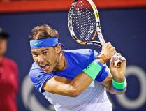 Rafael Nadal of Spain in action against Kei Nishikori of Japan during their quarterfinal match of the Open ATP tennis tournament in Montreal, Canada, 14 August 2015. (Tenis, Japón, España) EFE/EPA/ANDRE PICHETTE