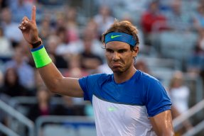 Rafael Nadal, of Spain, challenges a call during his match against Mikhail Youzhny, of Russia, at the Rogers Cup tennis tournament Thursday. Aug. 13, 2015, in Montreal. (Paul Chiasson/The Canadian Press via AP)
