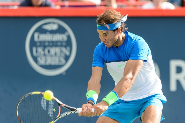 MONTREAL, ON - AUGUST 12:  Rafael Nadal of Spain hits a return against Sergiy Stakhovsky of Ukraine during day three of the Rogers Cup at Uniprix Stadium on August 12, 2015 in Montreal, Quebec, Canada.  Rafael Nadal defeated Sergiy Stakhovsky 7-6, 6-3.  (Photo by Minas Panagiotakis/Getty Images)