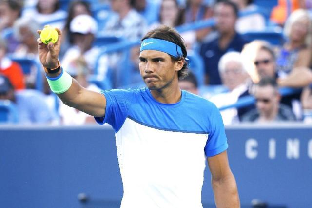 Rafael Nadal, of Spain, prepares to serve to Feliciano Lopez, of Spain, during a match at the Western & Southern Open tennis tournament, Thursday, Aug. 20, 2015, in Mason, Ohio. (AP Photo/John Minchillo)