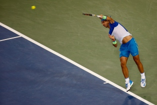 CINCINNATI, OH - AUGUST 19: Rafael Nadal of Spain serves to Jeremy Chardy of France during the Western & Southern Open at the Linder Family Tennis Center on August 19, 2015 in Cincinnati, Ohio. (Photo by Rob Carr/Getty Images)