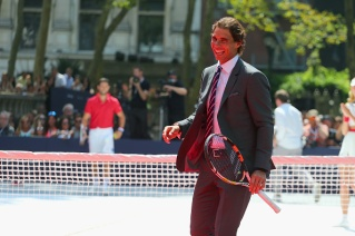 NEW YORK, NY - AUGUST 25: Rafael Nadal plays tennis at the Tommy Hilfiger and Rafael Nadal Global Brand Ambassadorship Launch at Bryant Park on August 25, 2015 in New York City. (Photo by Mike Stobe/Getty Images for Tommy Hilfiger)