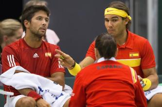 Fernando Verdasco and Rafael Nadal of Spain discuss tactics during the first set with team coach Conchita Martinez during their men's doubles Davis Cup tennis match against Denmark in Odense, Denmark September 19, 2015. REUTERS/Frank Cilius/Scanpix Denmark