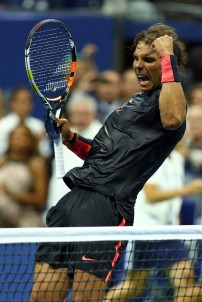 Rafael Nadal of Spain celebrates after defeating Borna Coric of Croatia during their Men's Singles First Round match on Day One of the 2015 US Open at the USTA Billie Jean King National Tennis Center on August 31, 2015 in the Flushing neighborhood of the Queens borough of New York City. (Aug. 30, 2015 - Source: Clive Brunskill/Getty Images North America)