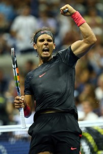 Rafael Nadal of Spain celebrates after defeating Borna Coric of Croatia during their Men's Singles First Round match on Day One of the 2015 US Open at the USTA Billie Jean King National Tennis Center on August 31, 2015 in the Flushing neighborhood of the Queens borough of New York City. (Aug. 30, 2015 - Source: Matthew Stockman/Getty Images North America)