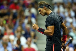 Rafael Nadal of Spain celebrates a point against Borna Coric of Croatia during their Men's Singles First Round match on Day One of the 2015 US Open at the USTA Billie Jean King National Tennis Center on August 31, 2015 in the Flushing neighborhood of the Queens borough of New York City.(Aug. 30, 2015 - Source: Clive Brunskill/Getty Images North America)