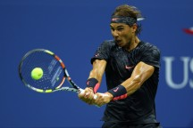 Rafael Nadal of Spain returns a shot against Borna Coric of Croatia during their Men's Singles First Round match on Day One of the 2015 US Open at the USTA Billie Jean King National Tennis Center on August 31, 2015 in the Flushing neighborhood of the Queens borough of New York City. (Aug. 30, 2015 - Source: Clive Brunskill/Getty Images North America)