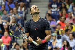 NEW YORK, NY - SEPTEMBER 04: Rafael Nadal of Spain reacts against Fabio Fognini of Italy on Day Five of the 2015 US Open at the USTA Billie Jean King National Tennis Center on September 4, 2015 in the Flushing neighborhood of the Queens borough of New York City. (Photo by Streeter Lecka/Getty Images)