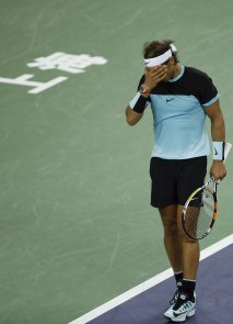 Rafael Nadal of Spain reacts after losing a point against Jo-Wilfried Tsonga of France during their men's singles semi-final match at the Shanghai Masters tennis tournament in Shanghai, China, October 17, 2015. REUTERS/Aly Song