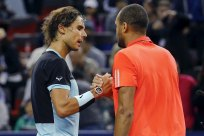 Jo-Wilfried Tsonga (R) of France is congratulated by Rafael Nadal of Spain after Tsonga beat Nadal in their men's singles semi-final match at the Shanghai Masters tennis tournament in Shanghai, China, October 17, 2015. REUTERS/Damir Sagolj