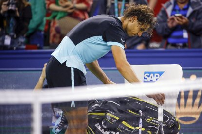 Rafael Nadal of Spain prepares to leave the court after losing to Jo-Wilfried Tsonga of France in their men's singles semi-final match at the Shanghai Masters tennis tournament in Shanghai, China, October 17, 2015. REUTERS/Damir Sagolj