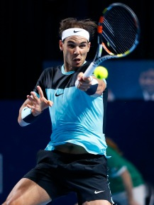 Rafael Nadal of Spain returns the ball to Bulgaria's Grigor Dimitrov during their match at the Swiss Indoors ATP men's tennis tournament in Basel, Switzerland October 28, 2015. REUTERS/Arnd Wiegmann