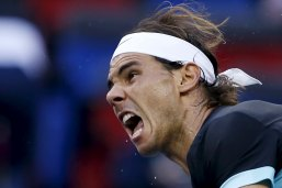 Rafael Nadal of Spain serves to Stan Wawrinka of Switzerland during their men's singles quarter-final match at the Shanghai Masters tennis tournament in Shanghai, China, October 16, 2015. REUTERS/Aly Song