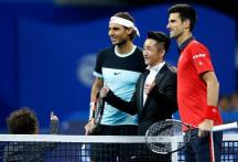 BEIJING, Oct. 11, 2015 (Xinhua) -- Novak Djokovic (R) of Serbia poses with Rafael Nadal (L) of Spain and Olympic boxing champion Zou Shiming of China ahead of the men's singles final at 2015 China Open Tennis Tournament at the National Tennis Center in Beijing, capital of China, Oct. 11, 2015. (Xinhua/Wang Lili/IANS)