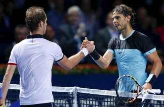 Rafael Nadal of Spain is congratulated by France's Richard Gasquet (L) after winning their semi-final at the Swiss Indoors ATP men's tennis tournament in Basel, Switzerland, October 31, 2015. REUTERS/Arnd Wiegmann