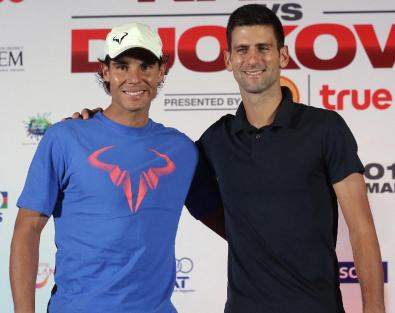 Rafael Nadal of Spain, left, and Novak Djokovic of Serbia, right, pose for photographers after a press conference for their exhibition tennis match in Bangkok, Thailand, Thursday, Oct. 1, 2015. The event will be held on Oct. 2.(AP Photo/Sakchai Lalit)