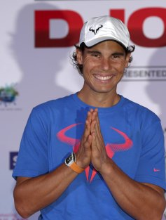 "Rafael Nadal of Spain poses for photographers after a news conference ahead of Friday's tennis friendly match against Novak Djokovic called ""Back To Thailand - Nadal vs Djokovic"" at a hotel in Bangkok, Thailand, October 1, 2015. REUTERS/Chaiwat Subprasom"
