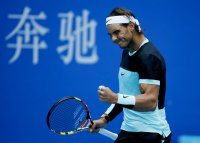 Rafa Nadal of Spain reacts after wining a point against Fabio Fognini of Italy during their men's singles semifinal match at the China Open tennis tournament in Beijing, China, October 10, 2015. REUTERS/Kim Kyung-Hoon
