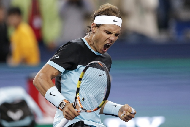 SHANGHAI, CHINA - OCTOBER 14: Rafael Nadal of Spain celebrates winning his men's singles second round match against Ivo Karlovic of Croatia on day 4 of Shanghai Rolex Masters at Qi Zhong Tennis Centre on October 14, 2015 in Shanghai, China. (Photo by Lintao Zhang/Getty Images)