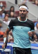 Rafael Nadal of Spain gestures after defeating Wu Di of China in the first round men's singles match of the China Open tennis tournament at the National Tennis Stadium in Beijing, Tuesday, Oct. 6, 2015. (AP Photo/Andy Wong)