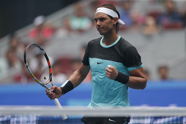 Rafael Nadal of Spain celebrates winning his semifinal match against Wu Di of China during the Men's singles first round match on day four of the 2015 China Open at the China National Tennis Centre on October 6, 2015 in Beijing, China. (Oct. 5, 2015 - Source: Lintao Zhang/Getty Images AsiaPac)