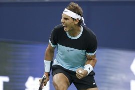 SHANGHAI, CHINA - OCTOBER 14: Rafael Nadal of Spain celebrates a point against Ivo Karlovic of Croatia during the men's singles second round match on day 4 of Shanghai Rolex Masters at Qi Zhong Tennis Centre on October 14, 2015 in Shanghai, China. (Photo by Lintao Zhang/Getty Images)