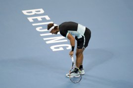 Rafa Nadal of Spain pauses after an injury during the men's singles final match against Novak Djokovic of Serbia at the China Open Tennis Tournament in Beijing, China, October 11, 2015. REUTERS/Jason Lee