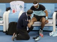 Rafa Nadal of Spain receives medical treatment on his foot during the men's singles final match against Novak Djokovic of Serbia at the China Open Tennis Tournament in Beijing, China, October 11, 2015. REUTERS/Jason Lee
