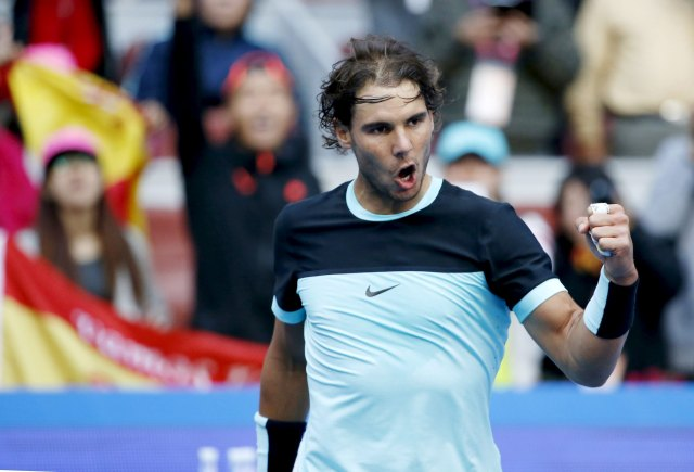 Rafa Nadal of Spain reacts after beating Jack Sock of U.S. during their men's singles match at the China Open tennis tournament in Beijing, China, October 9, 2015. REUTERS/Kim Kyung-Hoon