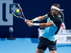 Rafael Nadal of Spain returns the ball to Croatia's Marin Cilic during their match at the Swiss Indoors ATP men's tennis tournament in Basel, Switzerland October 30, 2015. REUTERS/Arnd Wiegmann