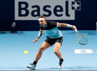 Spain's Rafael Nadal returns a ball to Bulgaria's Grigor Dimitrov during their match at the Swiss Indoors tennis tournament at the St. Jakobshalle in Basel, Switzerland, on Wednesday, Oct. 28, 2015. (Georgios Kefalas / Keystone via AP)