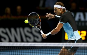 Rafael Nadal of Spain returns the ball to France's Richard Gasquet during their semi-final match at the Swiss Indoors ATP men's tennis tournament in Basel, Switzerland October 31, 2015. REUTERS/Arnd Wiegmann