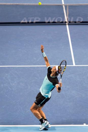 Spain's Rafael Nadal serves a ball to France's Richard Gasquet during their semifinal match at the Swiss Indoors tennis tournament at the St. Jakobshalle in Basel, Switzerland, Saturday, Oct. 31, 2015. (Georgios Kefalas/Keystone via AP)
