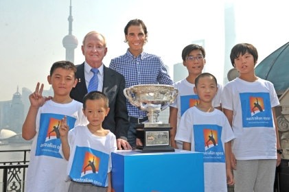 SHANGHAI, CHINA - OCTOBER 13: In this handout provided by Tennis Australia, Rod Laver and Rafael Nadal pose with the Norman Brookes Challenge Cup and local tennis fans during the international launch of the Australian Open 2016 at the Shook on October 13, 2015 in Shanghai, China. (Photo by Fiona Hamilton/Tennis Australia via Getty Images)