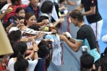 BANGKOK, THAILAND - OCTOBER 02: Rafael Nadal of Spain signs signature to the fan during the Rafael Nadal v Novak Djokovic exhibition match at Hua Mark Indoor Stadium on October 2, 2015 in Bangkok, Thailand. (Photo by Thananuwat Srirasant/Getty Images)