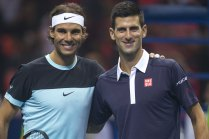 """Rafael Nadal of Spain (L) and Novak Djokovic of Serbia pose for photograph before their """"Back To Thailand - Nadal vs Djokovic"""" friendly tennis match in Bangkok, Thailand, October 2, 2015. REUTERS/Athit Perawongmetha"""